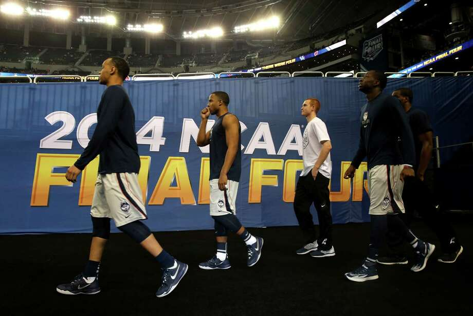 ARLINGTON, TX - APRIL 05: Shabazz Napier #13 of the Connecticut Huskies walks out to the floor prior to the NCAA Men's Final Four Semifinal against the Florida Gators at AT&T Stadium on April 5, 2014 in Arlington, Texas. Photo: Ronald Martinez, Getty Images / Getty Images