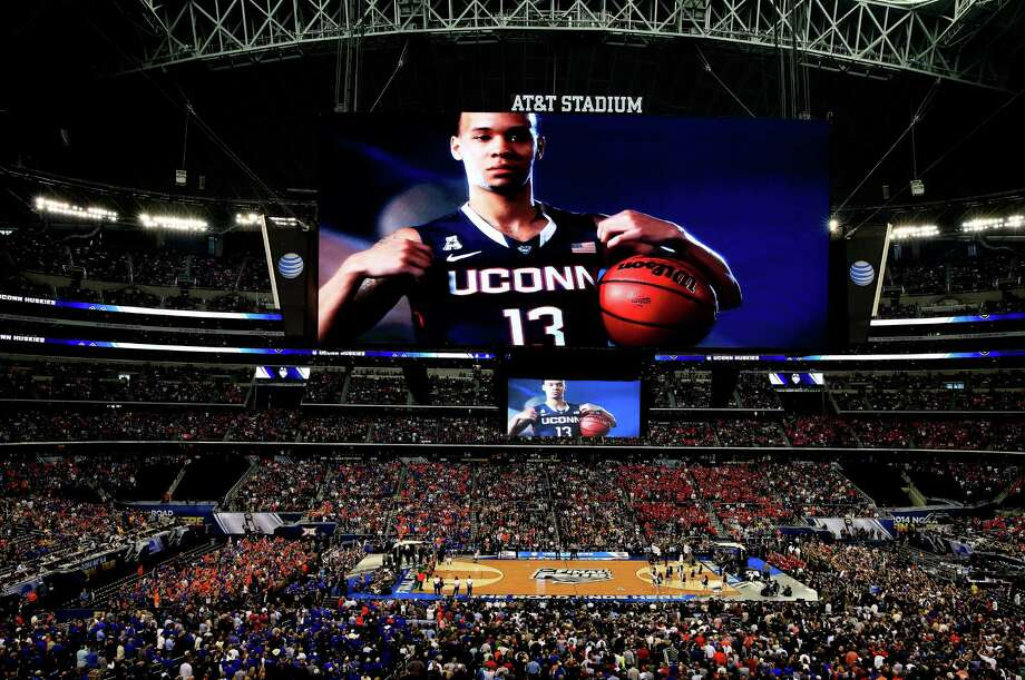 ARLINGTON, TX - APRIL 05: Shabazz Napier #13 of the Connecticut Huskies is introduced before the NCAA Men's Final Four Semifinal against the Florida Gators at AT&T Stadium on April 5, 2014 in Arlington, Texas. Photo: Jamie Squire, Getty Images / Getty Images