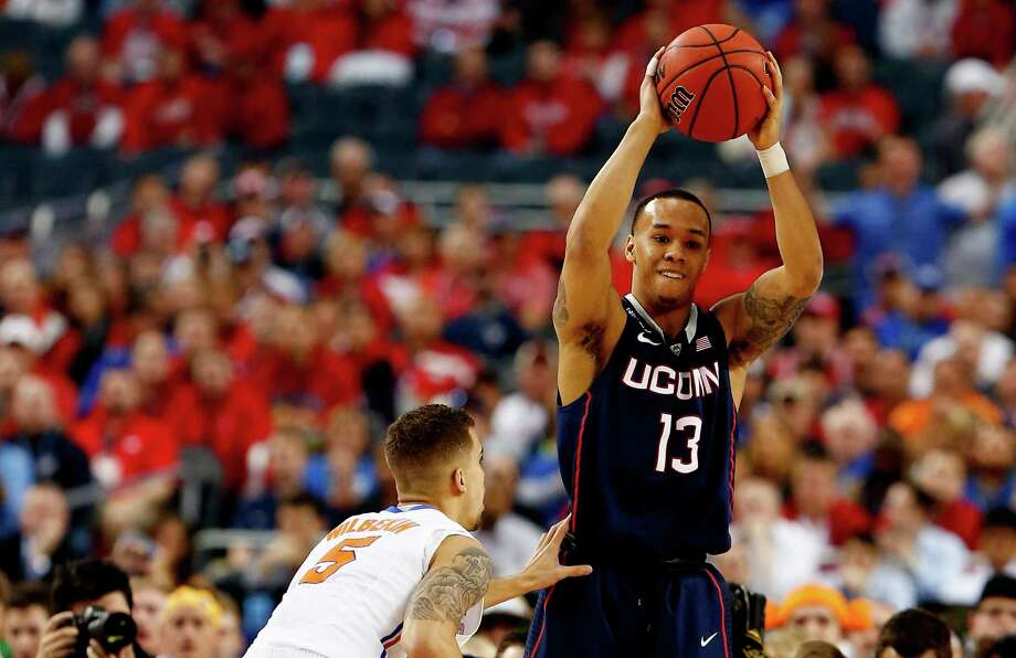 ARLINGTON, TX - APRIL 05: Shabazz Napier #13 of the Connecticut Huskies looks to pass as Scottie Wilbekin #5 of the Florida Gators defends during the NCAA Men's Final Four Semifinal at AT&T Stadium on April 5, 2014 in Arlington, Texas. Photo: Tom Pennington, Getty Images / Getty Images