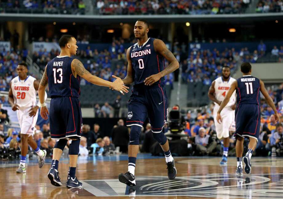 ARLINGTON, TX - APRIL 05: Shabazz Napier #13 and Phillip Nolan #0 of the Connecticut Huskies celebrate against the Florida Gators during the NCAA Men's Final Four Semifinal at AT&T Stadium on April 5, 2014 in Arlington, Texas. Photo: Ronald Martinez, Getty Images / Getty Images