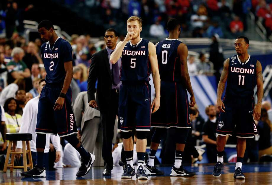 ARLINGTON, TX - APRIL 05: The Connecticut Huskies take the court during the NCAA Men's Final Four Semifinal against the Florida Gators at AT&T Stadium on April 5, 2014 in Arlington, Texas. Photo: Tom Pennington, Getty Images / Getty Images