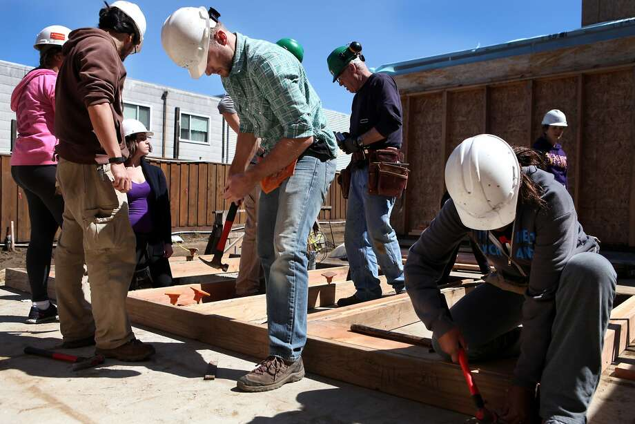 Volunteers from S.F. State University and Tech Workers for Affordable Housing help build a home with Habitat for Humanity. Photo: Deborah Svoboda, The Chronicle
