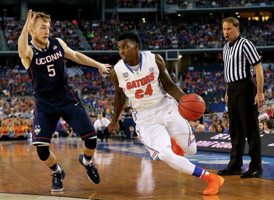 ARLINGTON, TX - APRIL 05: Casey Prather #24 of the Florida Gators drives to the basket as Niels Giffey #5 of the Connecticut Huskies defends during the NCAA Men's Final Four Semifinal at AT&T Stadium on April 5, 2014 in Arlington, Texas. Photo: Ronald Martinez, Getty Images / Getty Images