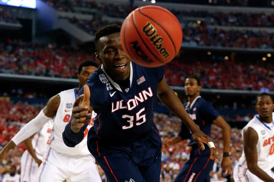 ARLINGTON, TX - APRIL 05: Amida Brimah #35 of the Connecticut Huskies goes for a loose ball against the Florida Gators during the NCAA Men's Final Four Semifinal at AT&T Stadium on April 5, 2014 in Arlington, Texas. Photo: Tom Pennington, Getty Images / Getty Images