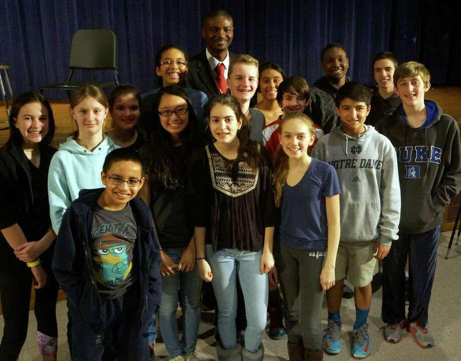 The anti-cyberbullying team at Western, from left: Isobel Wilson, Lindsay Tienken, Carlos Flores, Lauren Pecora, Tenzin Palkyi, Rene Jameson, Emily Phillipides, Assistant Principal Albert Sackey, Andrew Tienken, Keilly Moncada, Charlie Zeeve, Kristen Lewis, Zack Moore, Adante Joseph, Christian Rogers and Matthew Roer. Photo: Paul Schott, Anne W. Semmes / Greenwich Time