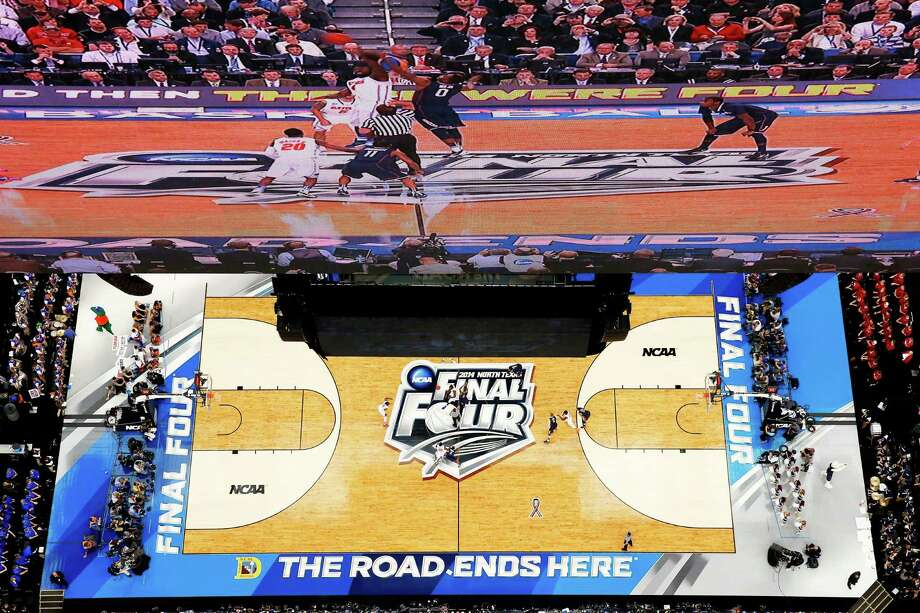 ARLINGTON, TX - APRIL 05:  Patric Young #4 of the Florida Gators and Phillip Nolan #0 of the Connecticut Huskies jump for the opening tip of the NCAA Men's Final Four Semifinal at AT&T Stadium on April 5, 2014 in Arlington, Texas. Photo: Tom Pennington, Getty Images / Getty Images