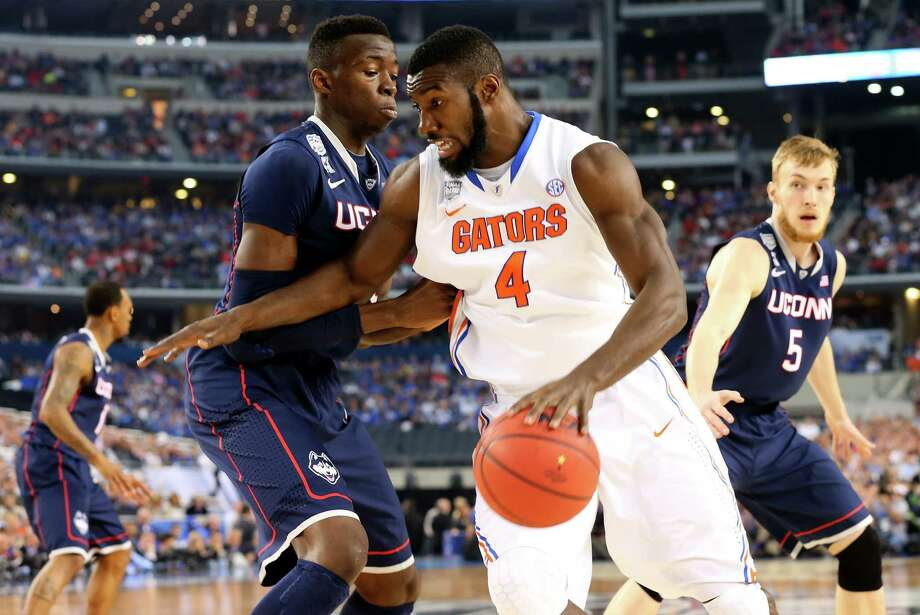 ARLINGTON, TX - APRIL 05: Patric Young #4 of the Florida Gators drives to the basket as Amida Brimah #35 of the Connecticut Huskies defends during the NCAA Men's Final Four Semifinal at AT&T Stadium on April 5, 2014 in Arlington, Texas. Photo: Ronald Martinez, Getty Images / Getty Images