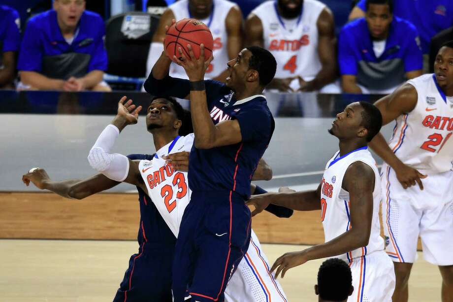 ARLINGTON, TX - APRIL 05: DeAndre Daniels #2 of the Connecticut Huskies battles for a loose ball against Chris Walker #23 of the Florida Gators during the NCAA Men's Final Four Semifinal at AT&T Stadium on April 5, 2014 in Arlington, Texas. Photo: Jamie Squire, Getty Images / Getty Images