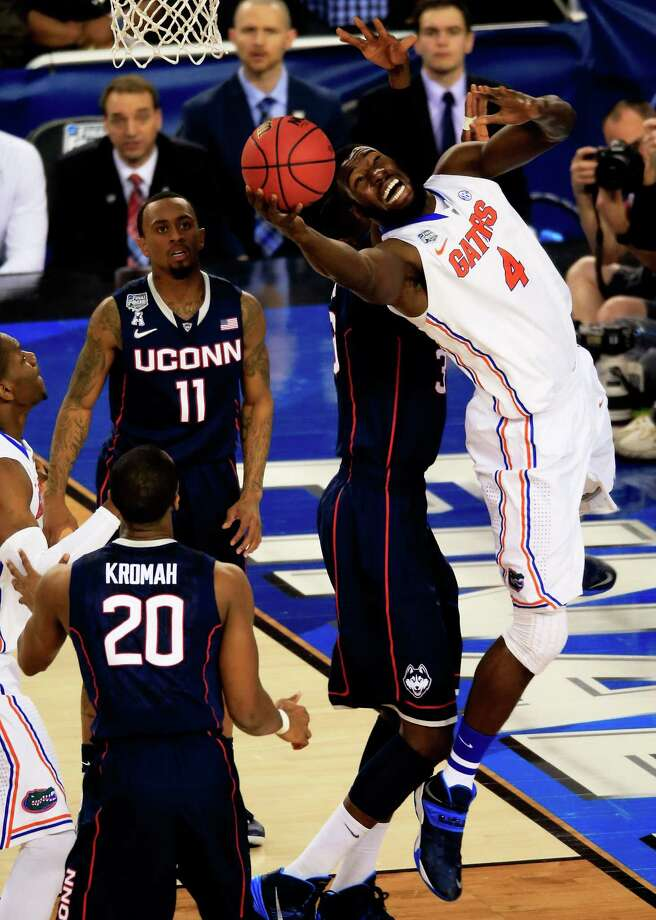 ARLINGTON, TX - APRIL 05: Patric Young #4 of the Florida Gators goes to the basket against Amida Brimah #35 of the Connecticut Huskies during the NCAA Men's Final Four Semifinal at AT&T Stadium on April 5, 2014 in Arlington, Texas. Photo: Jamie Squire, Getty Images / Getty Images
