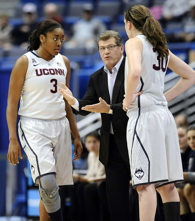 Geno Auriemma coaches Morgan Tuck (left) and Breanna Stewart this season. Photo: Jessica Hill, Associated Press