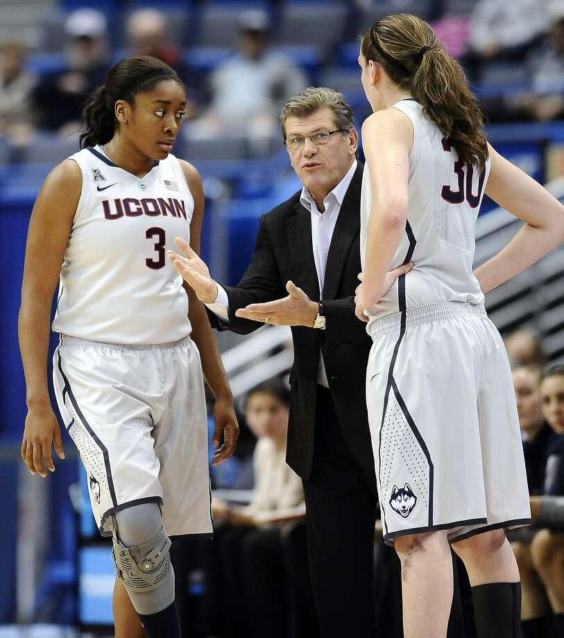 Geno Auriemma coaches Morgan Tuck (left) and Breanna Stewart this season. Photo: Jessica Hill, Associated Press