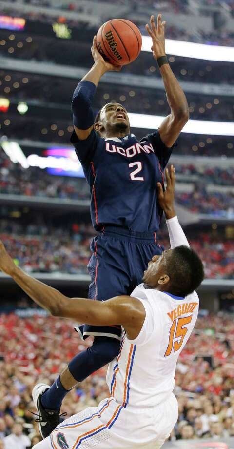 Connecticut forward DeAndre Daniels (2) shoots over Florida forward Will Yeguete (15) during the first half of the NCAA Final Four tournament college basketball semifinal game Saturday, April 5, 2014, in Arlington, Texas. Photo: David J. Phillip, AP / Associated Press