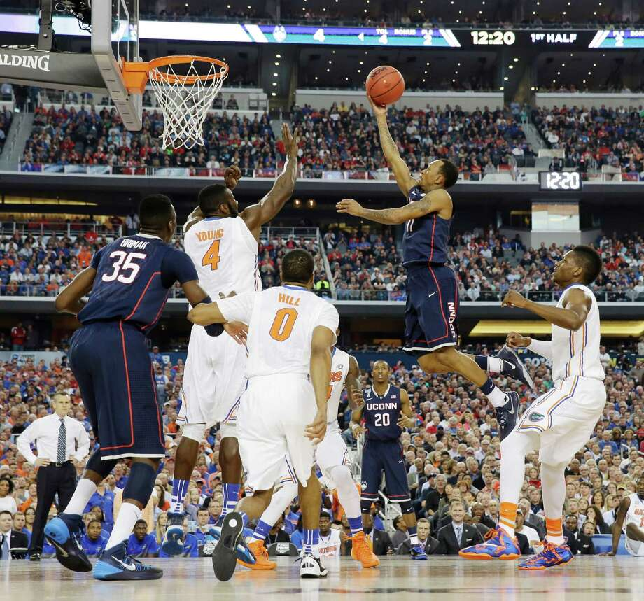 Connecticut guard Ryan Boatright shoots as Florida center Patric Young (4) defends during the first half of the NCAA Final Four tournament college basketball semifinal game Saturday, April 5, 2014, in Arlington, Texas. (AP Photo/David J. Phillip) Photo: David J. Phillip, ASSOCIATED PRESS / Associated Press