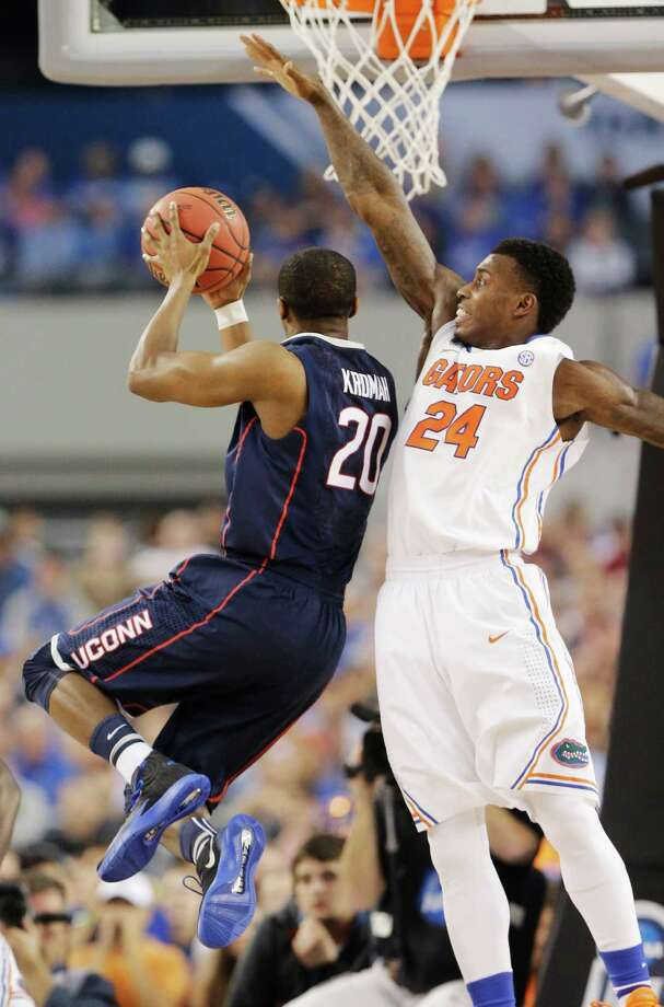 Connecticut guard/forward Lasan Kromah (20) shoots as Florida forward Casey Prather (24) defends during the first half of the NCAA Final Four tournament college basketball semifinal game Saturday, April 5, 2014, in Arlington, Texas. Photo: Eric Gay, AP / Associated Press