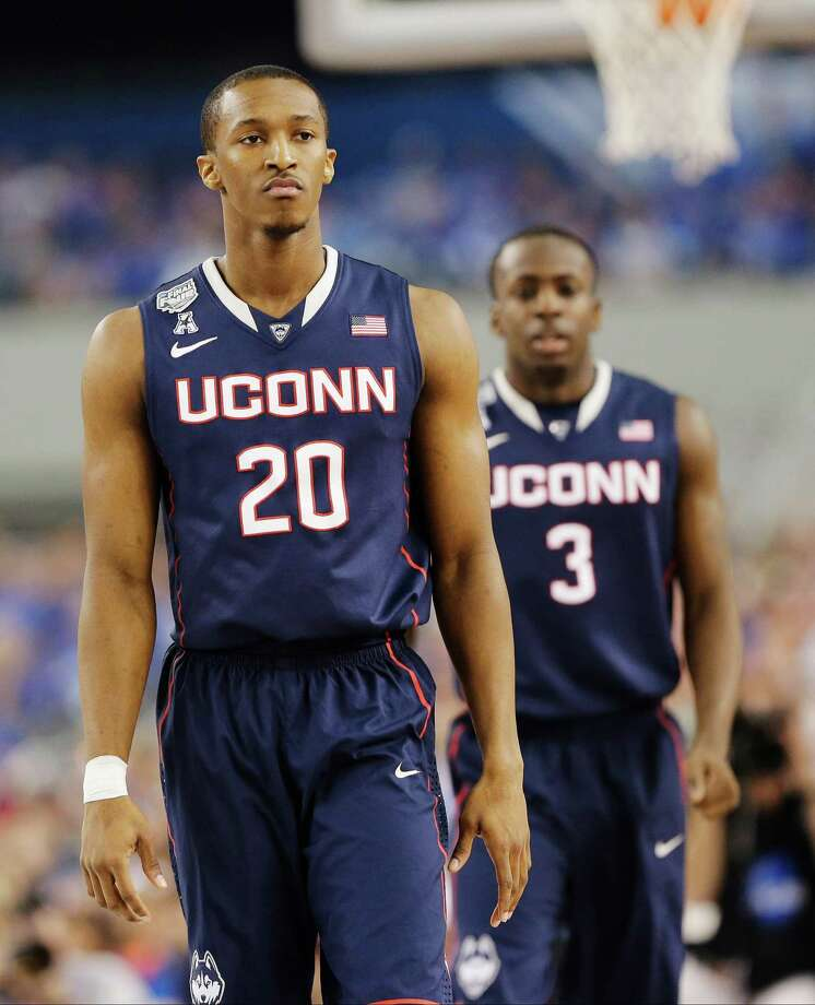 Connecticut guard Lasan Kromah (20), and Terrence Samuel (3) walk the floor between plays against Florida during the first half of the NCAA Final Four tournament college basketball semifinal game Saturday, April 5, 2014, in Arlington, Texas. Photo: Eric Gay, AP / Associated Press