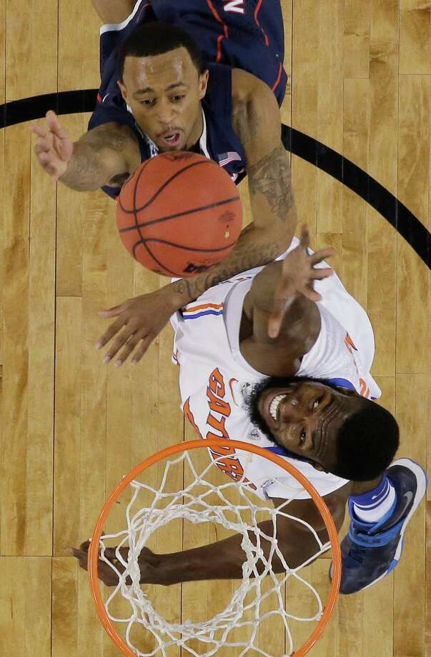 Connecticut guard Ryan Boatright, top, shoots over Florida center Patric Young during the first half of an NCAA Final Four tournament college basketball semifinal game Saturday, April 5, 2014, in Arlington, Texas. Photo: David J. Phillip, AP / Associated Press
