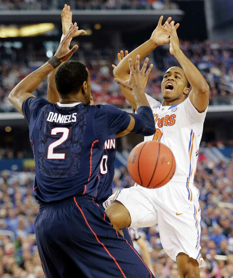 Connecticut forward DeAndre Daniels (2) and Florida guard Kasey Hill lose the ball during the first half of the NCAA Final Four tournament college basketball semifinal game Saturday, April 5, 2014, in Arlington, Texas. Photo: Eric Gay, AP / Associated Press