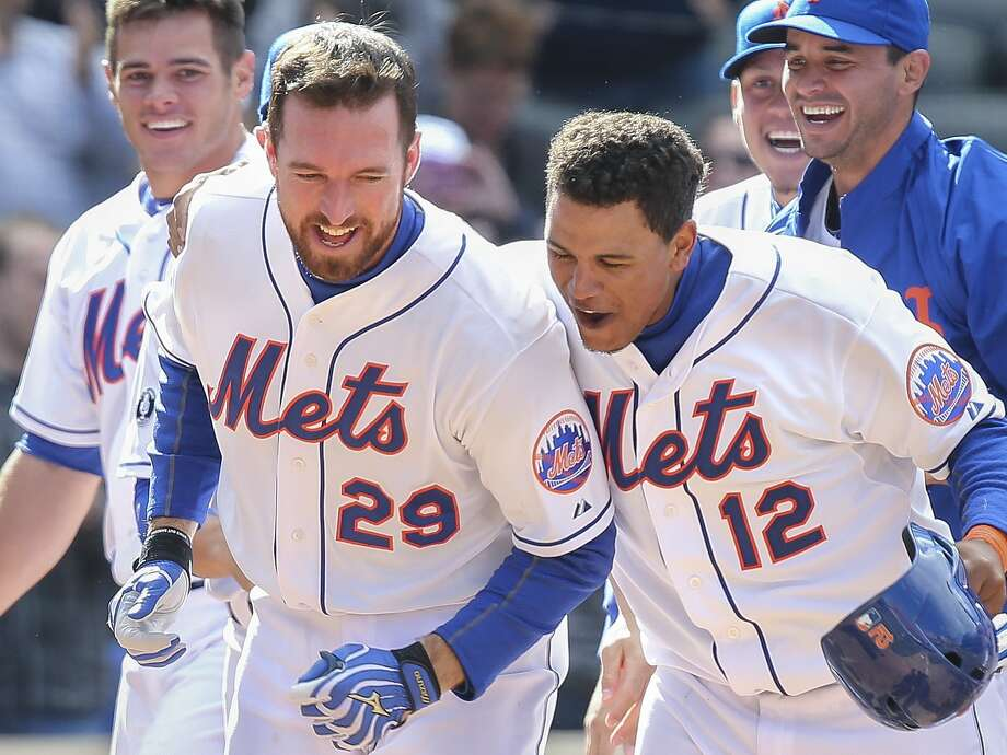 The Mets' Ike Davis celebrates after hitting a walk-off grand slam against the Reds. Photo: John Minchillo, Associated Press