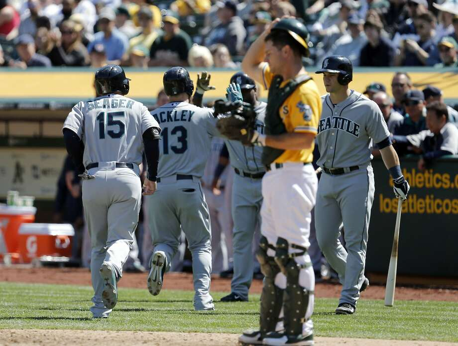 The A's John Jaso prepares for the next hitter after Seattle's Dustin Ackley scores on his two-run homer in the fifth inning. Photo: Michael Macor, The Chronicle