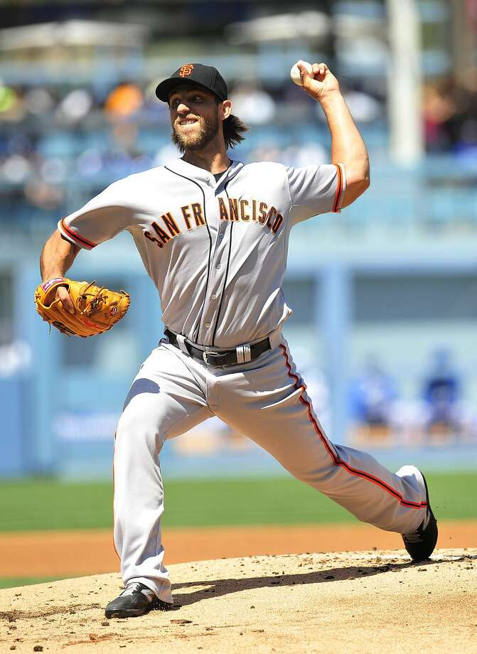Madison Bumgarner limited Los Angeles to two runs in 61/3 innings. Photo: Gary A. Vasquez, Reuters