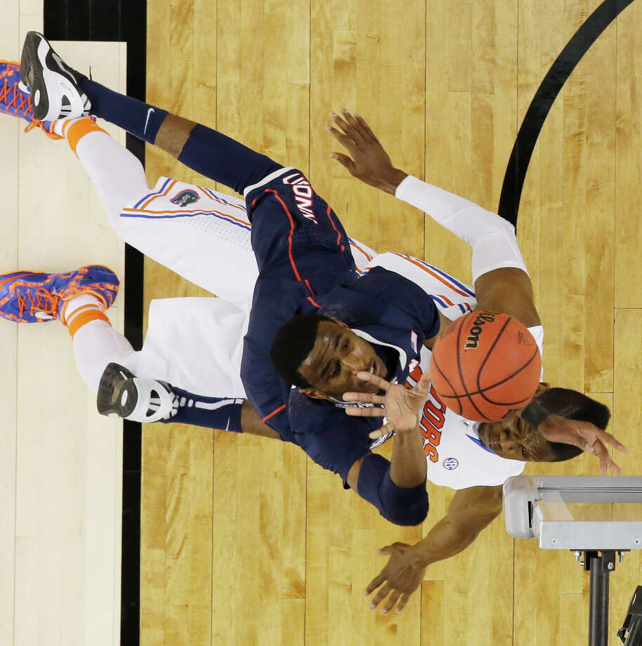 Connecticut forward DeAndre Daniels shoots over Florida forward Will Yeguete during the first half of the NCAA Final Four tournament college basketball semifinal game Saturday, April 5, 2014, in Arlington, Texas. Photo: David J. Phillip, AP / Associated Press