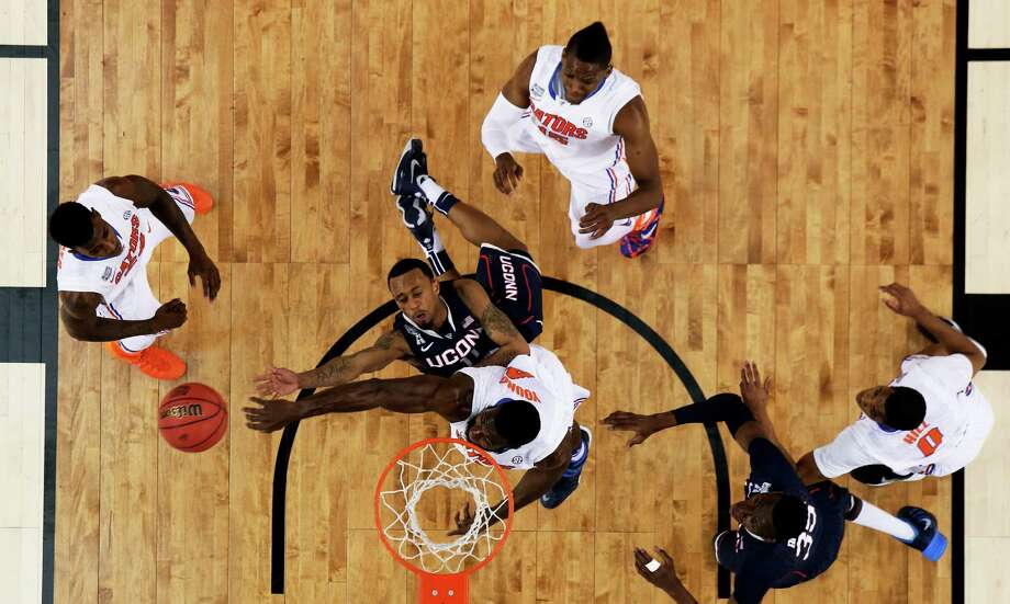 ARLINGTON, TX - APRIL 05: Ryan Boatright #11 of the Connecticut Huskies goes to the basket as Patric Young #4 of the Florida Gators defends during the NCAA Men's Final Four Semifinal at AT&T Stadium on April 5, 2014 in Arlington, Texas. Photo: Tom Pennington, Getty Images / Getty Images