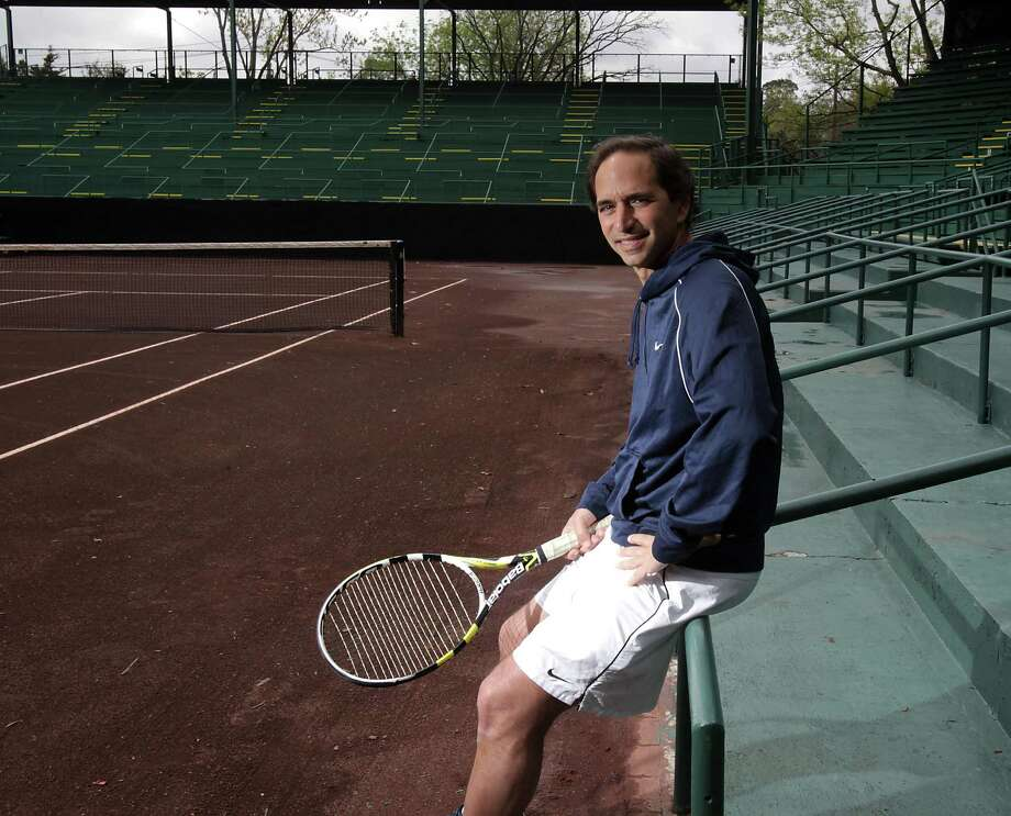 Sammy Giammalva Jr., 51, relaxes on Stadium Court at River Oaks Country Club, where, on a spring weekend in 1981, he pulled off an impressive run to the final. Photo: James Nielsen, Staff / © 2014  Houston Chronicle