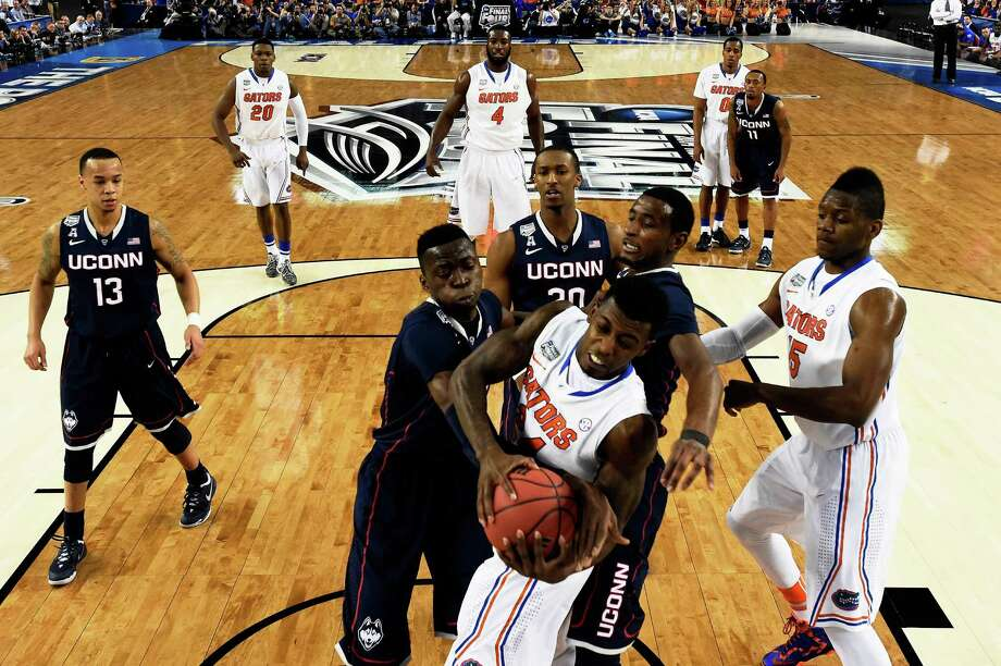 ARLINGTON, TX - APRIL 05: Casey Prather #24 of the Florida Gators and Amida Brimah #35 of the Connecticut Huskies battle for a rebound during the NCAA Men's Final Four Semifinal at AT&T Stadium on April 5, 2014 in Arlington, Texas. Photo: Pool, Getty Images / Getty Images