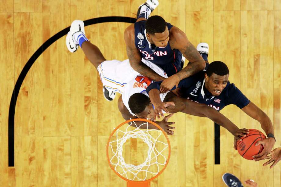 ARLINGTON, TX - APRIL 05: DeAndre Daniels #2 of the Connecticut Huskies battles for a rebound against Dorian Finney-Smith #10 of the Florida Gators during the NCAA Men's Final Four Semifinal at AT&T Stadium on April 5, 2014 in Arlington, Texas. Photo: Ronald Martinez, Getty Images / Getty Images