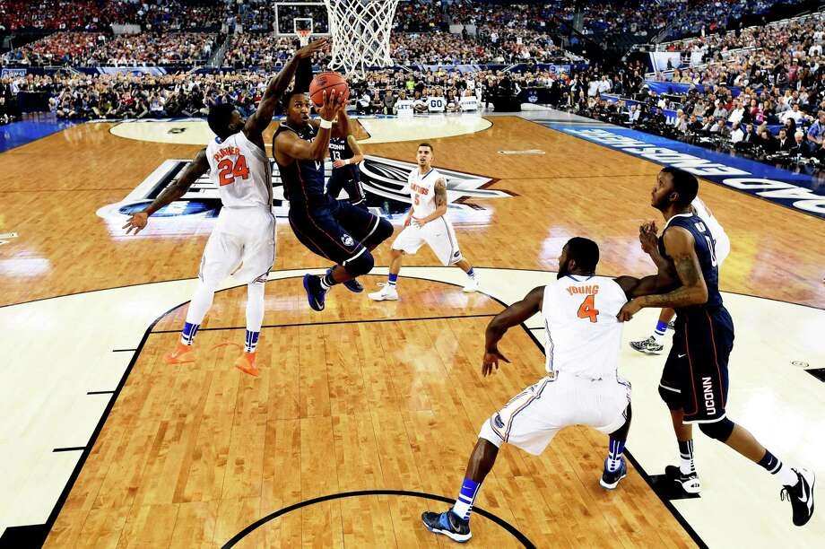 ARLINGTON, TX - APRIL 05:  Lasan Kromah #20 of the Connecticut Huskies goes to the basket against Casey Prather #24 of the Florida Gators during the NCAA Men's Final Four Semifinal at AT&T Stadium on April 5, 2014 in Arlington, Texas. Photo: Pool, Getty Images / Getty Images