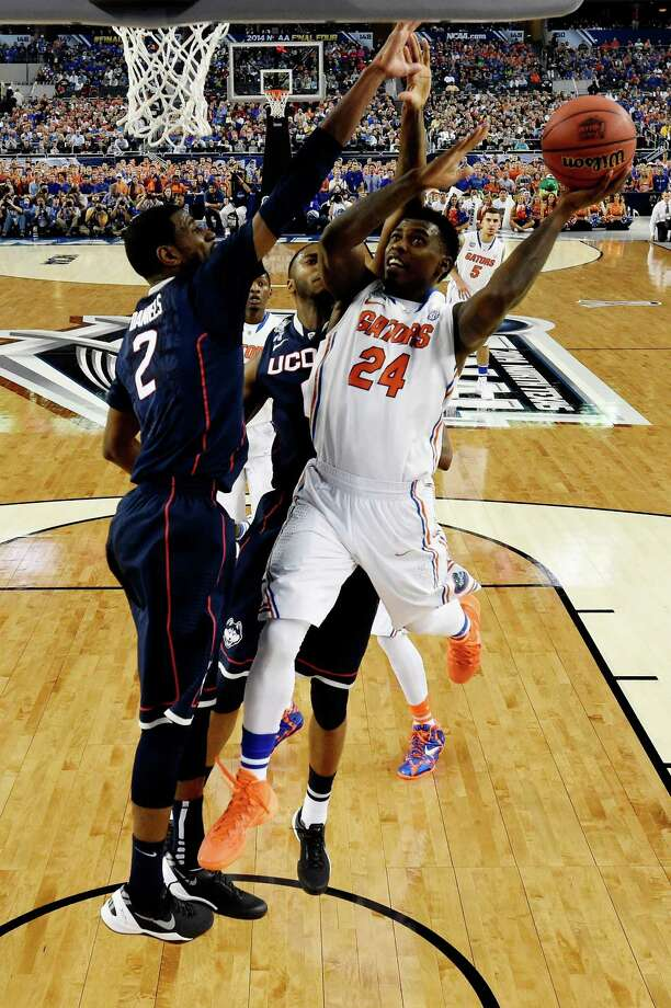 ARLINGTON, TX - APRIL 05: Casey Prather #24 of the Florida Gators goes up to the basket as DeAndre Daniels #2 of the Connecticut Huskies defends during the NCAA Men's Final Four Semifinal at AT&T Stadium on April 5, 2014 in Arlington, Texas. Photo: Pool, Getty Images / Getty Images