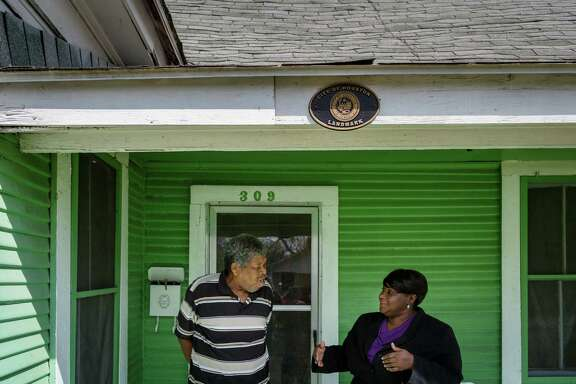 Charles Piper, left, talks with Tanya Debose outside his home which is both Federally and locally protected on the National Register in the Independence Heights area, Friday, March 21, 2014, in Houston. The neighborhood has a rich history with houses reflecting both the prosperity of the 1920s as well as the economic difficulties associated with The Great Depression and World War II.