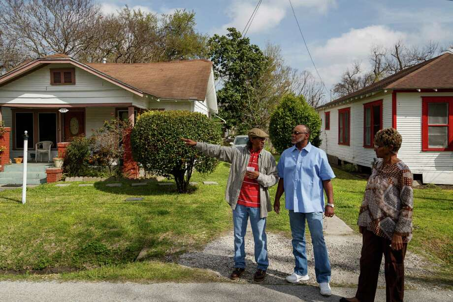 Doyle Johnson, left to right, David Williams and Ruth Jackson are residents of 31 1/2 Street a continuous block of 1930s-era homes in the Independence Heights that is protected from development and on the National and Local Historic District, Friday, March 21, 2014, in Houston. Photo: Michael Paulsen, Houston Chronicle / © 2014 Houston Chronicle
