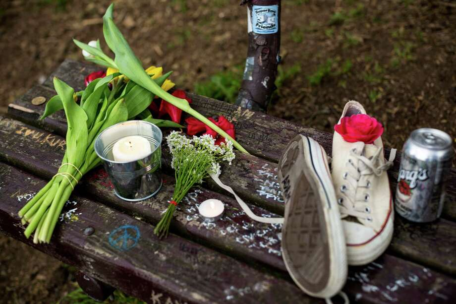 Fans of Nirvana's lead singer, Kurt Cobain, paid homage to the late rock icon with offerings of flowers, unopened beers and handwritten notes on a bench near the home where Cobain died on the 20th anniversary of his death Saturday, April 5, 2014, at Viretta Park in Seattle. On April 10, Nirvana will be inducted into the Rock and Roll Hall of Fame. Photo: JORDAN STEAD, SEATTLEPI.COM / SEATTLEPI.COM