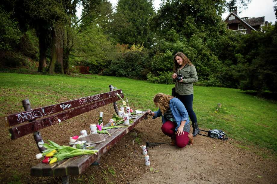 Nirvana fans who travelled from Georgia, Katlyn Reece, background, and Rachel Walraven, foreground, paid homage to the late Kurt Cobain, with handwritten notes on a bench near the home where Cobain died on the 20th anniversary of his death Saturday, April 5, 2014, at Viretta Park in Seattle. On April 10, Nirvana will be inducted into the Rock and Roll Hall of Fame. Photo: JORDAN STEAD, SEATTLEPI.COM / SEATTLEPI.COM
