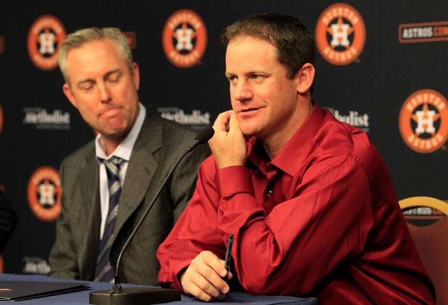 Astros president Reid Ryan listens as Roy Oswalt speaks about his fondest memories with the Astros. Photo: Karen Warren, Houston Chronicle