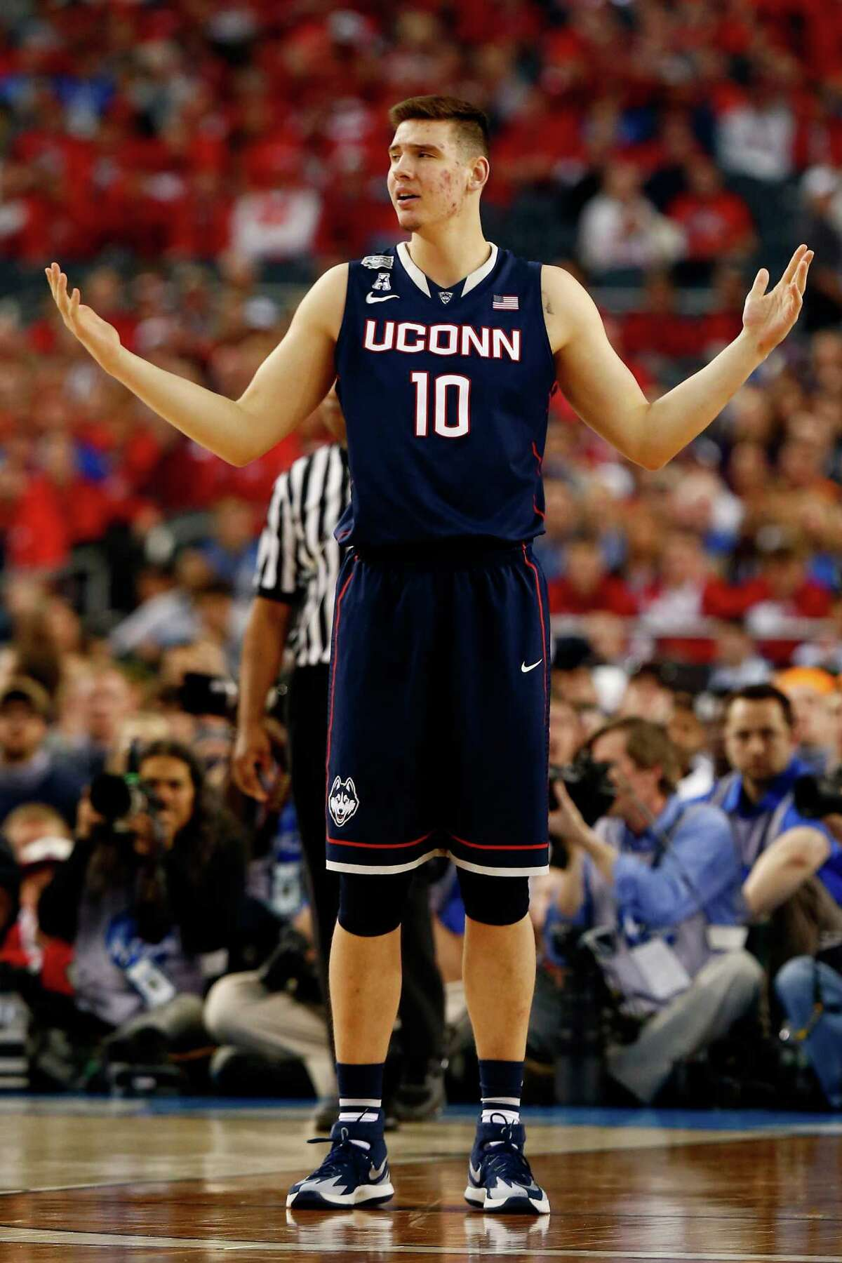 ARLINGTON, TX - APRIL 05: Tyler Olander #10 of the Connecticut Huskies reacts during the NCAA Men's Final Four Semifinal against the Florida Gators at AT&T Stadium on April 5, 2014 in Arlington, Texas.