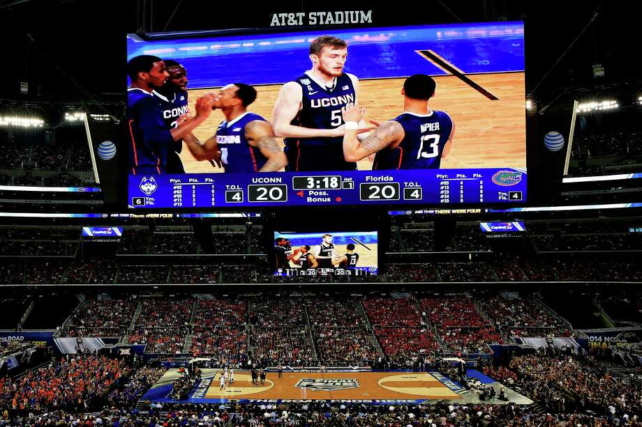 ARLINGTON, TX - APRIL 05: Shabazz Napier #13 and Niels Giffey #5 of the Connecticut Huskies celebrate against the Florida Gators during the NCAA Men's Final Four Semifinal at AT&T Stadium on April 5, 2014 in Arlington, Texas. Photo: Jamie Squire, Getty Images / Getty Images