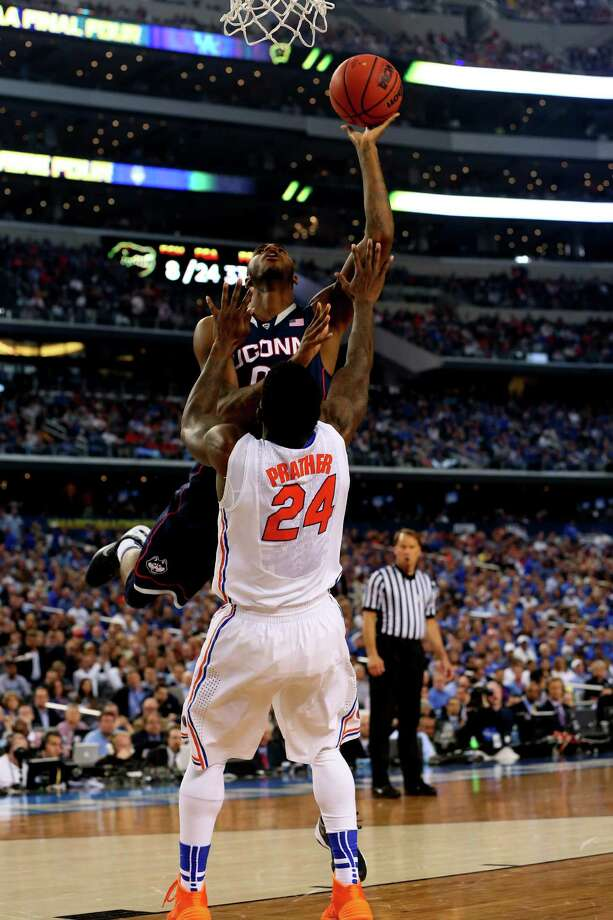 ARLINGTON, TX - APRIL 05:  Phillip Nolan #0 of the Connecticut Huskies goes up for a shot as Casey Prather #24 of the Florida Gators defends during the NCAA Men's Final Four Semifinal at AT&T Stadium on April 5, 2014 in Arlington, Texas. Photo: Ronald Martinez, Getty Images / Getty Images