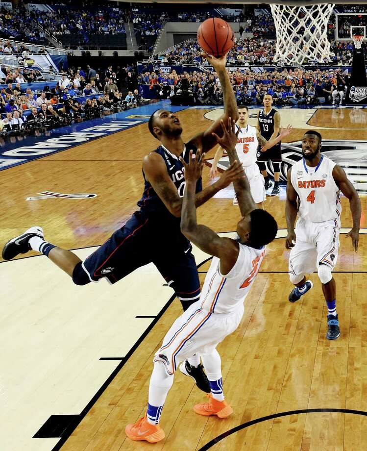ARLINGTON, TX - APRIL 05:  Phillip Nolan #0 of the Connecticut Huskies goes up for a shot as Casey Prather #24 of the Florida Gators defends during the NCAA Men's Final Four Semifinal at AT&T Stadium on April 5, 2014 in Arlington, Texas. Photo: Pool, Getty Images / Getty Images