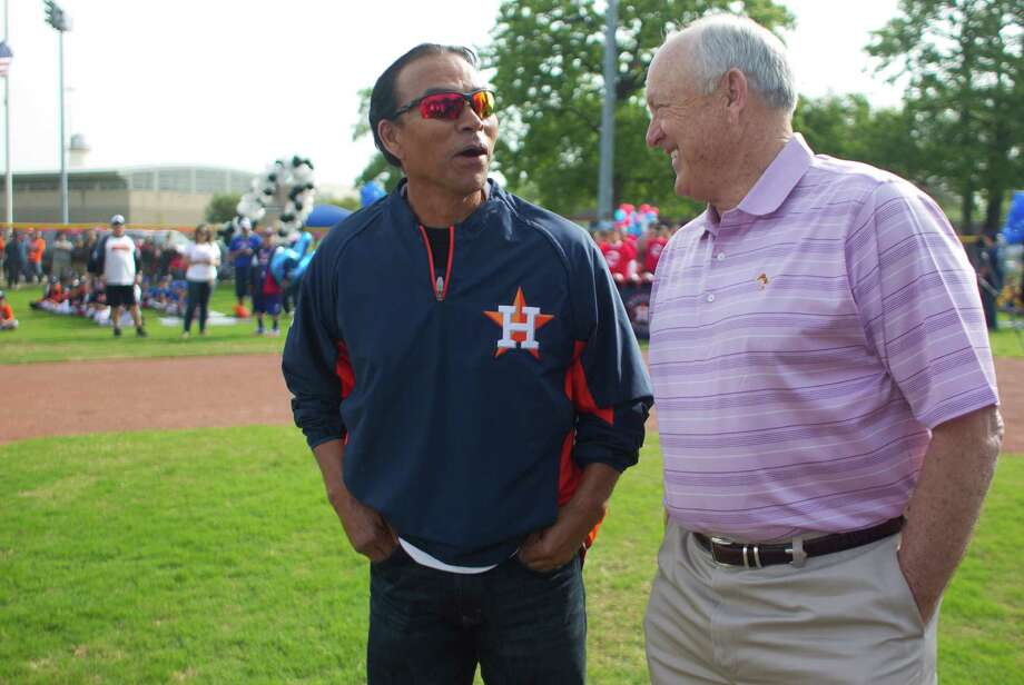 Astros Executive Advisor Nolan Ryan and Astros alumnus and community outreach executive Jose Cruz share a laugh on the newly revitalized youth baseball fields at Denver Harbor Park. Photo: Johnny Hanson, Houston Chronicle / © 2014  Houston Chronicle