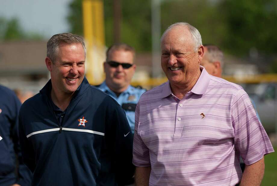 Astros President of Business Operations Reid Ryan and his father and Astros Executive Advisor Nolan Ryan share a laugh at the newly revitalized youth baseball fields at Denver Harbor Park. Photo: Johnny Hanson, Houston Chronicle / © 2014  Houston Chronicle
