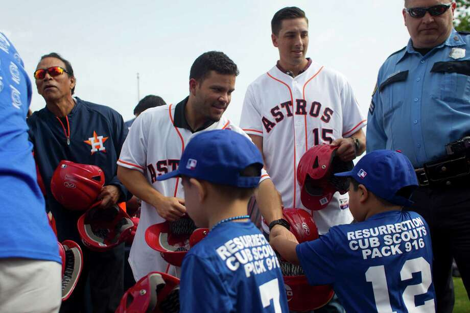Denver Harbor Little Leaguers are given new baseball helmets provided by the Occidental Petroleum Corporation, by former Astro, Jose Cruz, and current Astros, Jose Altuve and Jason Castro at the Denver Harbor Little League's newly revitalized youth baseball fields at Denver Harbor Park. Photo: Johnny Hanson, Houston Chronicle / © 2014  Houston Chronicle