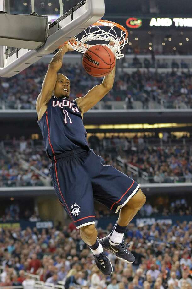 Connecticut guard Ryan Boatright dunks the ball during the second half of the NCAA Final Four tournament college basketball semifinal game against Florida Saturday, April 5, 2014, in Arlington, Texas. Photo: Eric Gay, AP / Associated Press