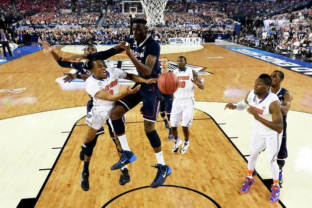 ARLINGTON, TX - APRIL 05: Kasey Hill #0 of the Florida Gators goes to the basket as Amida Brimah #35 of the Connecticut Huskies defends during the NCAA Men's Final Four Semifinal at AT&T Stadium on April 5, 2014 in Arlington, Texas. Photo: Pool, Getty Images / 2014 Getty Images