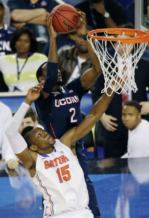 Connecticut forward DeAndre Daniels (2) controls the ball as Florida forward Will Yeguete (15) defends during the second half of the NCAA Final Four tournament college basketball semifinal game Saturday, April 5, 2014, in Arlington, Texas. Photo: Tony Gutierrez, AP / Associated Press