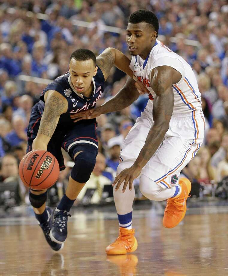Connecticut guard Shabazz Napier, left, drives past Florida forward Casey Prather during the second half of an NCAA Final Four tournament college basketball semifinal game Saturday, April 5, 2014, in Arlington, Texas. Photo: Eric Gay, AP / Associated Press