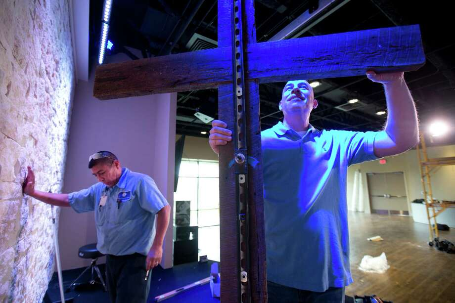 Jeff Rees, Houston First Baptist Church's Sienna Plantation campus pastor, prepares to install a decorative cross in the new service and worship congregation room of the newly opened Missouri City site. The church has four campuses. Photo: Marie D. De Jesus, Staff / © 2014 Houston Chronicle
