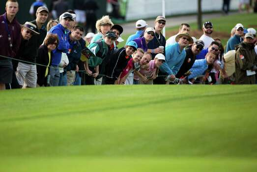 Golf enthusiasts watch the tee shots from the first hole fairway on round three of the Shell Houston Open at the Golf Club of Houston, Saturday, April 5, 2014, in Humble. Photo: Marie D. De Jesus, Houston Chronicle / © 2014 Houston Chronicle