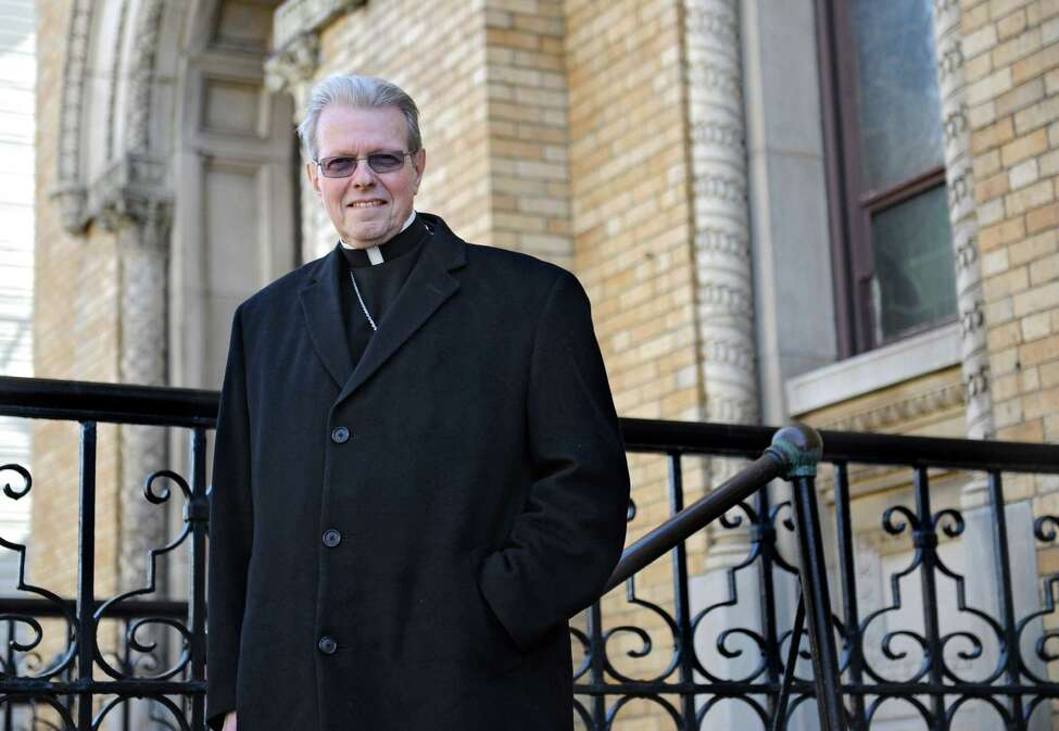 Bishop-elect Edward Scharfenberger stands outside of St Aloysius church on Friday, March 21, 2014 in Queens, N.Y. Scharfenberger was baptized in this church. (Lori Van Buren / Times Union)